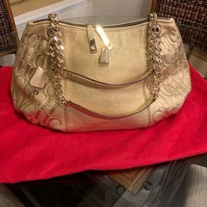 Carolina Herrera gold handbag